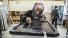 An Egyptian man casts his vote during a referendum on the new Egyptian constitution at a polling station on December 15, 2012 in Cairo, Egypt. Source: edition.cnn.com